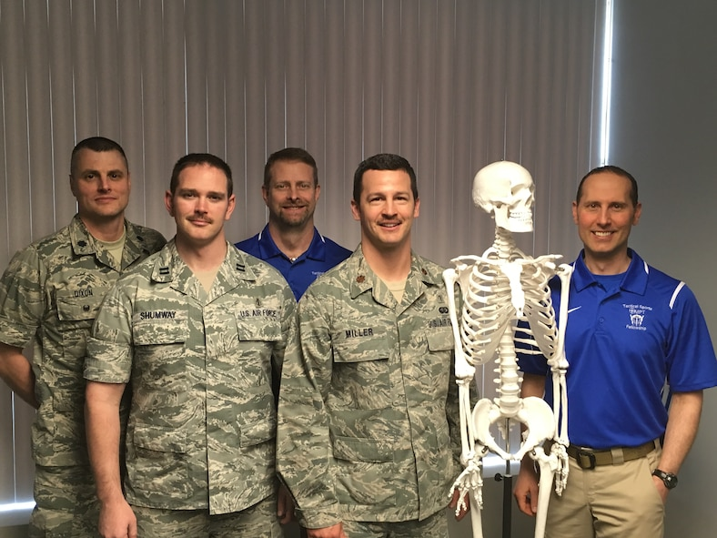 The Air Force Tactical Sports and Orthopedic Manual Physical Therapy Fellowship staff, faculty and current fellows. From left to right: Lt. Col. Joel Dixon (Assistant Fellowship Program Director), Capt. (Dr.) Joshua Shumway (Fellow in Training), Dr. Eric Wilson (Fellowship Program Director), Maj. (Dr.) Ronald Miller (Fellow in Training), Dave The Skeleton (Fellowship Senior Training Aid), Dr. Derek Vraa (Fellowship Senior Faculty Member)