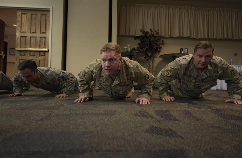 Airmen from the 38th Rescue Squadron perform ceremonial push-ups, March 3, 2017, at Moody Air Force Base, Ga. The push-ups were done in memory of Senior Airman Jason Cunningham and to honor retired Tech. Sgt. Keary Miller, for his brave actions during the battle of Roberts Ridge. (U.S. Air Force photo by Airman 1st Class Lauren M. Sprunk)