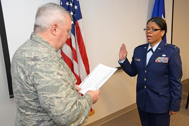 A picture of New Jersey National Guard Adjutant General Brig. Gen. Michael Cunniff swearing in U.S. Air Force 1st Lt. Anita Morris, a chaplain with the  New Jersey Air National Guard's 177th Fighter Wing, at her swearing-in ceremony, Feb. 12, 2017, at the 177th Fighter Wing.
