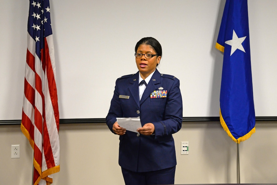 U.S. Air Force 1st Lt. Anita Morris, a chaplain with the New Jersey Air National Guard's 177th Fighter Wing, speaks to a group of senior leaders, friends and family during her swearing-in ceremony, Feb. 12, 2017, at the 177th Fighter Wing, Egg Harbor Township, New Jersey.  Morris is the wing's first African-American female chaplain. (U.S. Air National Guard photo by Senior Airman Shane Karp/Released)