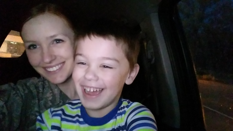 U.S. Air Force Senior Airman Katie Cogbill, 19th Medical Operations Squadron medical technician, takes a selfie with her son, Barrett. (Courtesy photo)