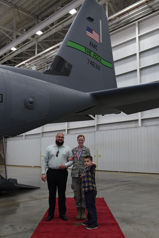 U.S. Air Force Senior Airman Katie Cogbill, 19th Medical Operations Squadron medical technician, poses for a photo with her husband, Daniel, and her son, Barrett, during the 2016 19th Airlift Wing Annual Awards ceremony Jan. 27, 2017, at Little Rock Air Force Base, Ark. Cogbill went up against four other Airmen from the 19th AW to win the award. (U.S. Air Force photo by Airman 1st Class Kevin Sommer Giron)