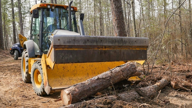 U.S. Air Force Airman 1st Class James Noble, a civil engineer with the 116th Air Control Wing, Georgia Air National Guard, removes trees cut down while clearing a 20-foot wide, 1.5 mile trail through a five-acre area at Wellston Park, Warner Robins, Ga., March 5, 2017. The engineers partnered with the City of Warner Robins to assist in the completion of Wellston Park through the Innovative Readiness Training (IRT) program. The IRT program is a US military volunteer training opportunity that provides training and readiness for military personnel while addressing public and civil-society needs. (U.S. Air National Guard photo by Senior Master Sgt. Roger Parsons)