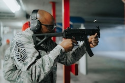 Chief Master Sgt. of the Air Force Kaleth O. Wright shoots an MP5 submachine gun at the firing range at Joint Base Andrews, Md., March 14, 2017. Wright's visit afforded him the opportunity to learn from and interact with Airmen of the 11th Security Support Squadron. (U.S. Air Force photo by Senior Airman Delano Scott)