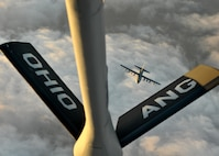 A U.S. Air Force MC-130J Commando II with the 9th Special Operations Squadron approaches a KC-135R Stratotanker with the 121st Air Refueling Wing, Ohio Air National Guard, for refueling during a training sortie in support of Emerald Warrior 17 March 7, 2017. Emerald Warrior is a U.S. Special Operations Command exercise during which joint special operations forces train to respond to various threats across the spectrum of conflict. (U.S. Air National Guard photo by Senior Airman Ashley Williams)