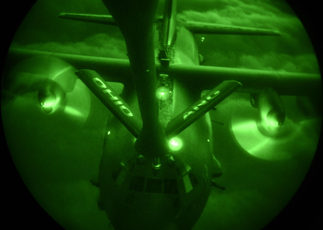 A U.S. Air Force AC-130U Spooky with the 4th Special Operations Squadron receives fuel from a KC-135R Stratotanker with the 121st Air Refueling Wing, Ohio Air National Guard, for refueling during a training sortie in support of Emerald Warrior 17 March 7, 2017. Emerald Warrior is a U.S. Special Operations Command exercise during which joint special operations forces train to respond to various threats across the spectrum of conflict. (U.S. Air National Guard photo by Senior Airman Ashley Williams)