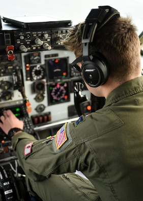 A U.S. Air Force pilot with the 121st Air Refueling Wing, Ohio Air National Guard performs pre-flight checks of a KC-135R Stratotanker during a training sortie in support of Emerald Warrior 17 March 7, 2017. Emerald Warrior is a U.S. Special Operations Command exercise during which joint special operations forces train to respond to various threats across the spectrum of conflict. (U.S. Air National Guard photo by Senior Airman Ashley Williams)