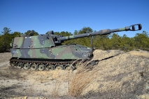 A demilitarized 155mm M109 self-propelled howitzer serves as a target at the 177th Fighter Wing Det. 1 - Warren Grove Bombing Range in Burlington County, N.J. on Mar. 2, 2017. The realistic target was acquired from the Defense Logistics Agency Reutilization Transfer Donation program. (U.S. Air National Guard photo by Master Sgt. Andrew J. Moseley/Released)