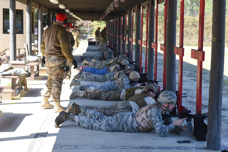 Combat Arms Training and Maintenance instructors with the 1st Special Operations Security Forces Squadron supervise Air Commandos as they fire their M4 rifles down range during a weapons qualification course at Hurlburt Field, Fla., March 16, 2017. Instructors watch the students' techniques and performance take notes on how to help them improve firing techniques. (U.S. Air Force photo by Senior Airman Jeff Parkinson)