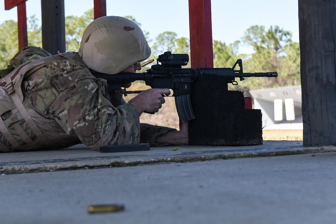 Master Sgt. Derek Zarnesky, flight chief with the 11th Special Operations Intelligence Squadron, fires his M4 rifle during a weapons qualification course at the Combat Arms Training and Maintenance range, Hurlburt Field, Fla., March 16, 2017. Air Commandos are required to qualify on the M9 pistol and M4 rifle prior to deploying to certain locations around the world. (U.S. Air Force photo by Senior Airman Jeff Parkinson)