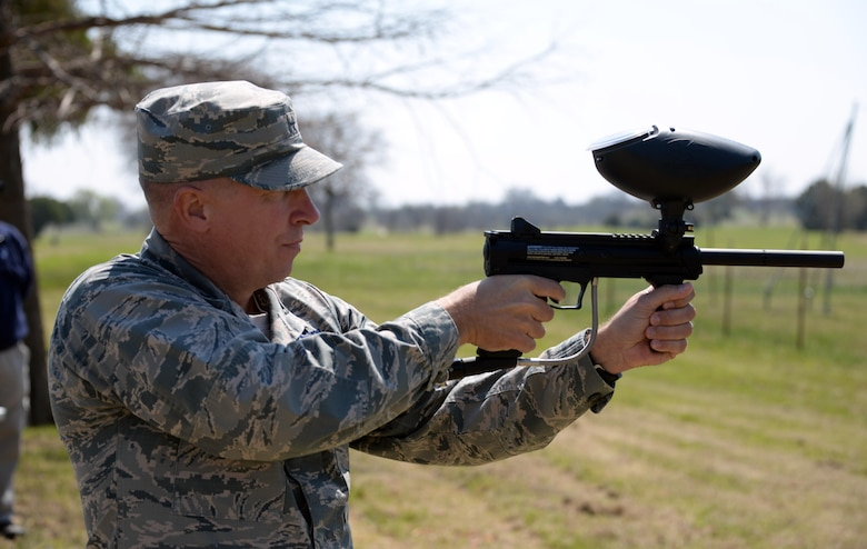 Brig. Gen. Patrick Doherty, 82nd Training Wing commander, test fires a paintball marker shortly after cutting the ribbon for the grand opening of the paintball facility at Sheppard Air Force Base, Texas, March 15, 2017. Along with the paintball facility, Wind Creek Park also offers a dog park, disc golf course and a jogging path. (U.S. Air Force photo by Senior Airman Robert L. McIlrath/Released)