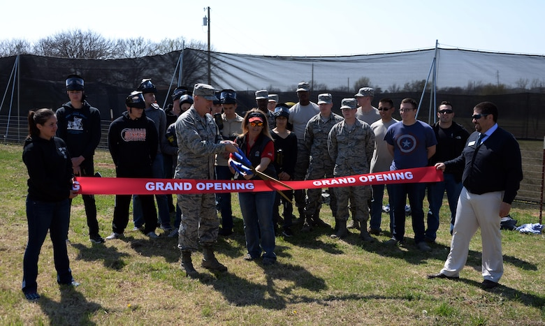 Brig. Gen. Patrick Doherty, 82nd Training Wing commander, along with Elizabeth Clements, Outdoor Recreation director, cut the ribbon during the grand opening of the paintball facility at Wind Creek Park on Sheppard Air Force Base, Texas, March 15, 2017. (U.S. Air Force photo by Senior Airman Robert L. McIlrath/Released)