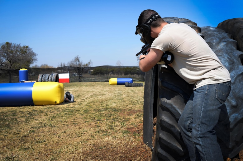 Airmen-in-Training at Sheppard Air Force Base, Texas, take some of the first shots at the paintball arena at Wind Creek Park shortly after its grand opening March 15, 2017. The paintball facility will be open on Saturday's from 12 p.m. to 5 p.m. Participants are allowed to bring their own gear but must purchase paintballs from Outdoor Recreation. (U.S. Air Force photo by Senior Airman Robert L. McIlrath/Released)