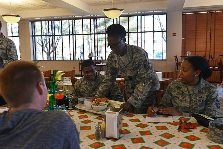 U.S. Air Force Master Sgt. Atricia Trice, 20th Logistics Readiness Squadron first sergeant, serves an Airman his meal during a birthday dinner at Shaw Air Force Base, S.C., March 15, 2017. Leadership from around the 20th Fighter Wing served their Airmen dinner and spent time with them while they ate to show their appreciation. (U.S. Air Force photo by Airman 1st Class Destinee Sweeney)