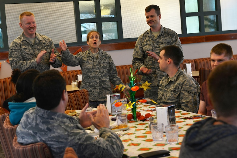 "Leadership from the 20th Fighter Wing sing ""Happy Birthday"" to Airmen during a birthday dinner at Shaw Air Force Base, S.C., March 15, 2017. Monthly birthday dinners are an opportunity for Airmen to network with others and for their leadership to mentor them. (U.S. Air Force photo by Airman 1st Class Destinee Sweeney)"