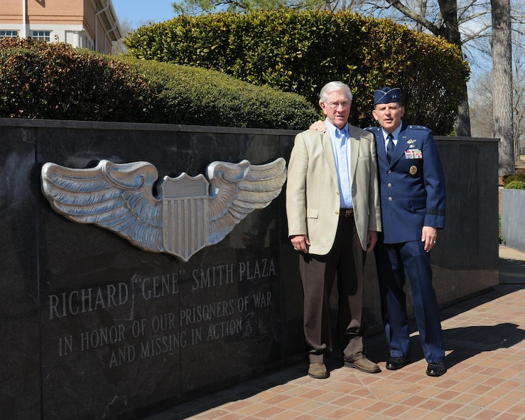 "Retired Lt. Col. Richard ""Gene"" Smith, former Vietnam POW, poses for a photo with retired Maj. Gen Jack Catton, former 14th Flying Training Wing Commander March 14, 2014, at the Memorial Wall on Columbus Air Force Base, Mississippi. March 14 marked the 44th anniversary of Smith's repatriation."