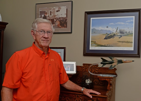 "Retired Lt. Col. Richard ""Gene"" Smith stands next to a model F-105 Thunderchief aircraft June 29, 2015, at his home in West Point, Mississippi. He spent over five years as a prisoner of war in Vietnam after ejecting from his aircraft in 1967."