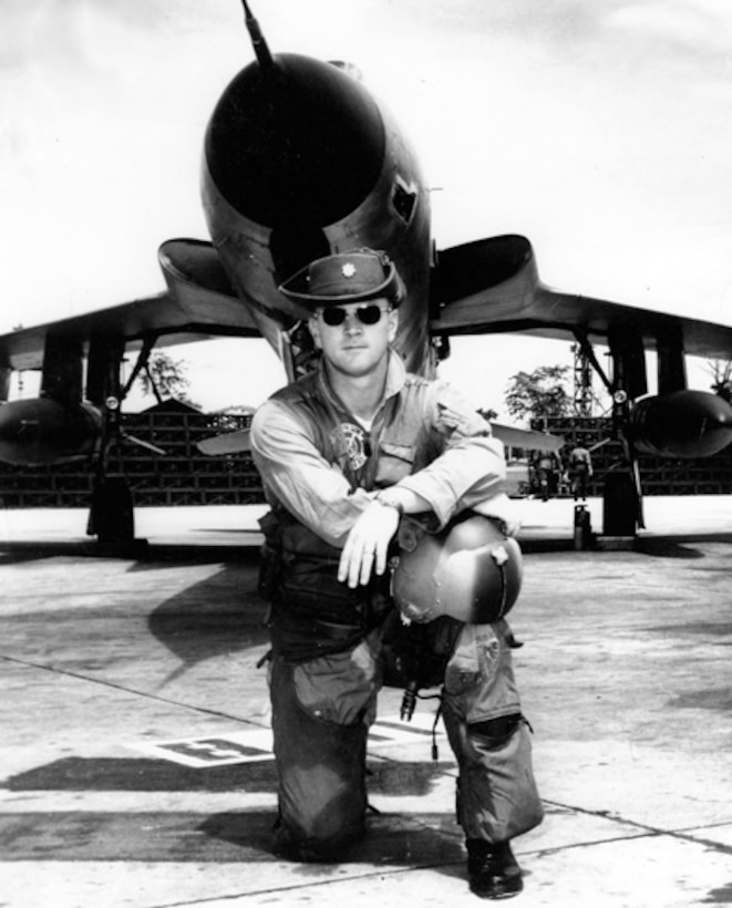 """Then Maj. Richard """"Gene"""" Smith poses for a photo in front of his F-105 Thunderchief in 1967 in South East Asia. For his time at Columbus Air Force Base, Mississippi, and his bravery during his years as a POW, the Ceremonial Plaza in front of the wing headquarters building was renamed the Richard """"Gene"""" Smith Plaza."""