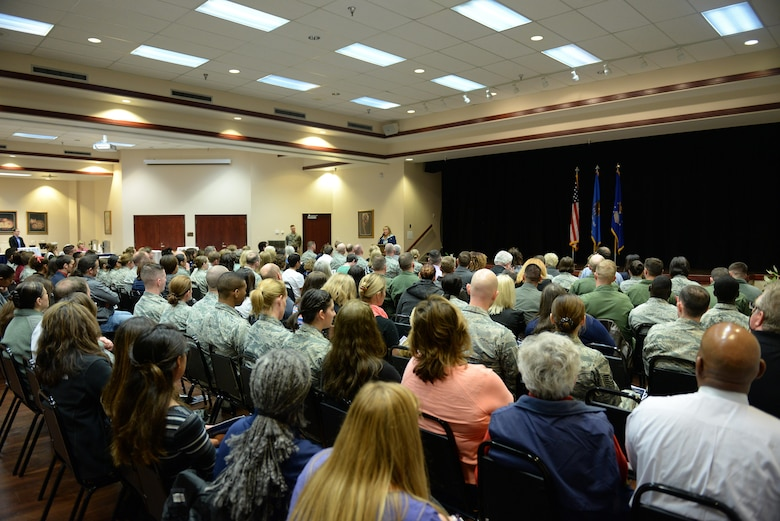 Attendees of the Altus Air Force Base Women's History Month celebration, listen to Oklahoma Gov. Mary Fallin's speech, March 16, 2017, at Altus AFB, OK. This event gave the opportunity for the base to honor and recognize women in the work force, past and present. (U.S. Air Force photo by Airman 1st Class Cody Dowell/released)