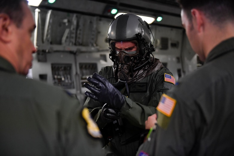 Capt. Jason Carroll, 15th Airlift Squadron airdrop instructor pilot before a flight to North Auxiliary Airfield in North, South Carolina, March 15, 2017 to execute in-flight training with aircrew eye and respiratory protection system (AERPS) equipment. The flight marked the first time in more than 10 years where aircrews wore AERPS equipment. AERPS equipment consists of a rubber mask, multiple layers of boots and gloves, fan filter system and an audio and speaker system.