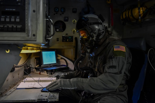 Senior Airman Grant Smart, 15th Airlift Squadron loadmaster, performs preflight checks before a flight to North Auxiliary Airfield in North, South Carolina, March 15, 2017 to execute in-flight training with aircrew eye and respiratory protection system (AERPS) equipment. The flight marked the first time in more than 10 years where aircrews wore AERPS equipment. AERPS equipment consists of a rubber mask, multiple layers of boots and gloves, fan filter system and an audio and speaker system.