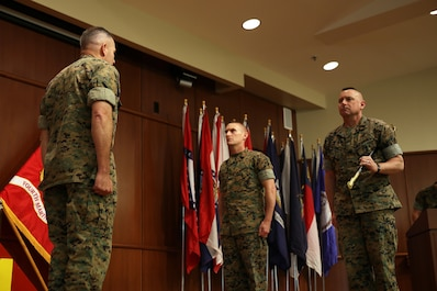 Brig. Gen. Paul K. Lebidine (left), commanding general of 4th Marine Division, Sgt. Maj. Michael A. Miller (middle), incoming sergeant major of 4th MARDIV and Sgt. Maj. Daniel W. Fliegel (right), outgoing sergeant major of 4th MARDIV, participate in a relief and appointment and retirement ceremony at Marine Corps Support Facility New Orleans, March 16, 2017. Composed of more than 17,000 Marines, 4th MARDIV is the biggest division command in the Marine Corps. (U.S. Marine Corps photo by Pfc. Niles Lee/Released)