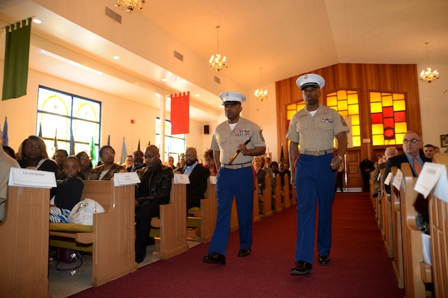 Sgt. Maj. Kenneth V. Agee, left, outgoing sergeant major, Marine Corps Logistics Base Albany, transfers senior staff noncommissioned officer authority to Sgt. Maj. Johnny L. Higdon, incoming sergeant major, during a post and relief ceremony at the Chapel of the Good Shepherd, here, March 16.