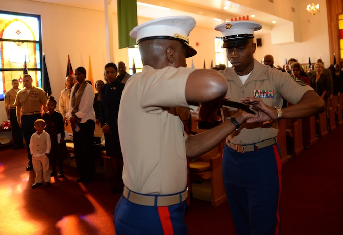 Sgt. Maj. Johnny L. Higdon, sergeant major, Marine Corps Logistics Base Albany, receives a noncommissioned officer's sword from Col. James C. Carroll III, commanding officer, MCLB Albany, completing the transfer of senior staff noncommissioned officer authority during a post and relief ceremony at the Chapel of the Good Shepherd, here, March 16.