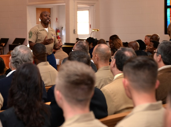 Sgt. Maj. Johnny L. Higdon, sergeant major, Marine Corps Logistics Base Albany, addresses Marines and civilian-Marines during a post and relief ceremony at the Chapel of the Good Shepherd, here, March 16.