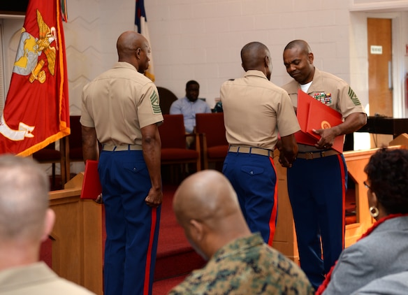 Sgt. Maj. Kenneth V. Agee, former sergeant major, Marine Corps Logistics Base Albany, receives several certificates during a retirement ceremony at the Chapel of the Good Shepherd, here, March 16.