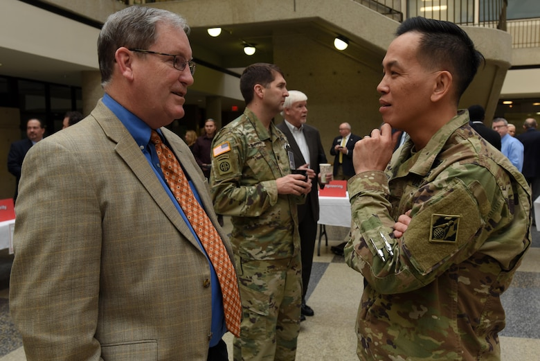 Brig. Gen. Mark Toy, U.S. Army Corps of Engineers Great Lakes and Ohio River Division commander, talks with Mike Wilson, Nashville District deputy for Programs and Project Management, during the First Annual Nashville District Small Business Opportunities Open House at Tennessee State University in Nashville, Tenn., March 16, 2017. The event gave business leaders direct access to Nashville District officials from across the organization.