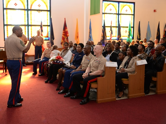 Sgt. Maj. Kenneth V. Agee, former sergeant major, Marine Corps Logistics Base Albany, addresses family members, Marines and civilian-Marines during a retirement ceremony at the Chapel of the Good Shepherd, here, March 16.