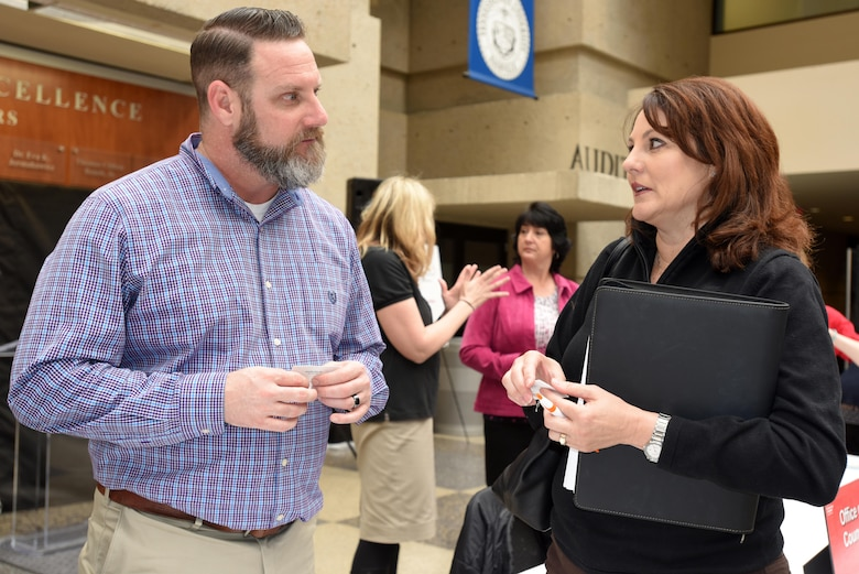 Josh Lowery, Nashville District Safety Office, speaks with Cynthia Bullard, sales representative at Scientific Sales, Inc., in Oak Ridge, Tenn., during the First Annual Nashville District Small Business Opportunities Open House at Tennessee State University in Nashville, Tenn., March 16, 2017. The event gave business leaders direct access to Nashville District officials from across the organization.
