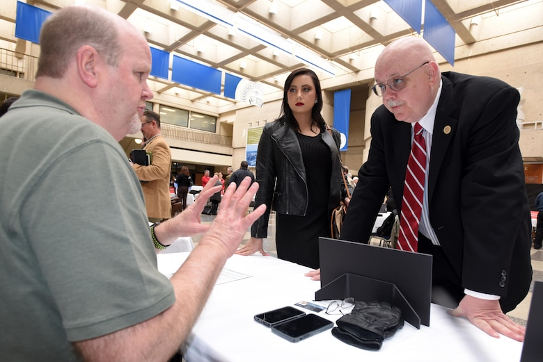 Ron Douglas (sitting), U.S. Army Corps of Engineers Nashville District Information Technology chief, provides information to Scott Allen, chief executive officer of Wisdom Tree Technologies, and Valerie Daquilla, executive assistant, during the First Annual Nashville District Small Business Opportunities Open House at Tennessee State University in Nashville, Tenn., March 16, 2017.