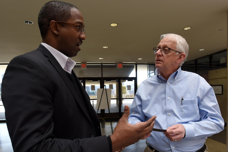 Ray Algood (Right), U.S. Army Corps of Engineers Nashville District facility manager, speaks with Charles E. Lewis Jr., professional engineer and vice president of A.G. Gaston Construction in Birmingham, Ala., during the First Annual Nashville District Small Business Opportunities Open House at Tennessee State University in Nashville, Tenn., March 16, 2017.