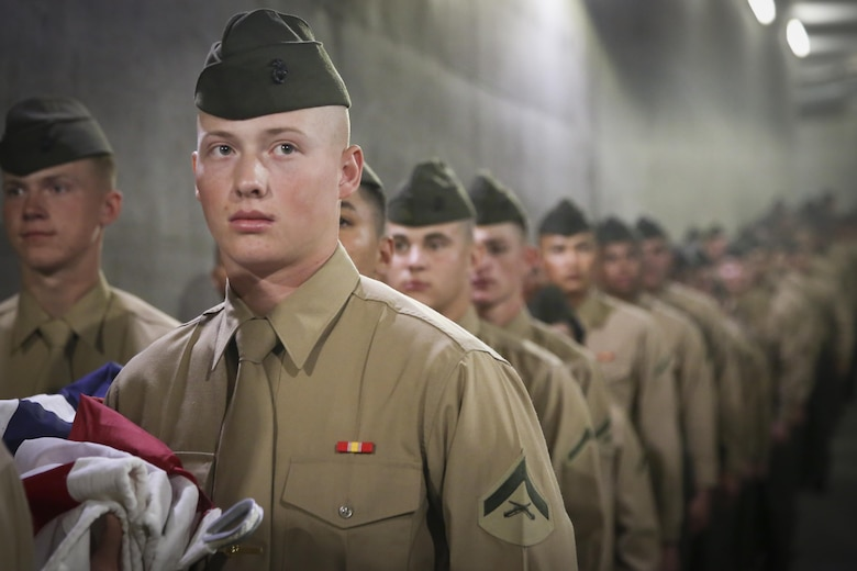 "Lance Cpl. Cole Dalton, student, Marine Corps Communication-Electronics School, prepares to present the national colors during the 15th Banque Nationale de Paris Paribas Open's ""Salute to Heroes,"" in Indian Wells, Calif., March 10, 2017. This event began in 2002 after Sept. 11, and is meant to celebrate, recognize and honor all service men and women as well as first responders. (U.S. Marine Corps photo by Cpl. Medina Ayala-Lo)"