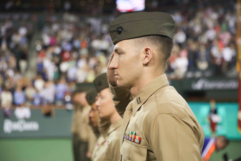 "Capt. Christopher Rock, data training platoon commander, Marine Corps Communication-Electronics School, salutes the national colors during the 15th Banque Nationale de Paris Paribas Open's ""Salute to Heroes,"" in Indian Wells, Calif., March 10, 2017. This event began in 2002 after Sept. 11, and is meant to celebrate, recognize and honor all service men and women as well as first responders. (U.S. Marine Corps photo by Cpl. Medina Ayala-Lo)"