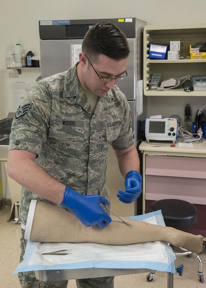 Staff Sgt. Joshua Woods, 366th Medical Group aerospace medical technician, demonstrates the correct way to stitch a wound March 16, 2017, at Mountain Home Air Force Base, Idaho. Aerospace medical technicians learn their craft at Ft. Sam Houston, Texas, during their 98 day technical school. (U.S. Air Force photo by Airman Jeremy D. Wolff/Released)