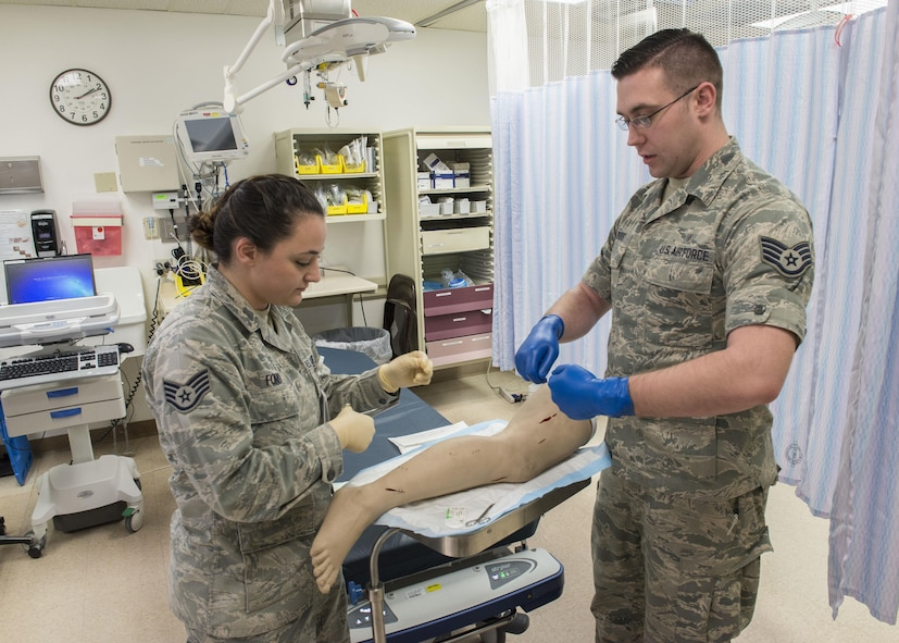 Staff Sgts. Heather Ford (left) and Joshua Woods, 366th Medical Operations Squadron aerospace medical technicians, complete a medical training scenario March 16, 2017, at Mountain Home Air Force Base, Idaho. Everyone in health care plays a role in safe care of patients from medical technicians to doctors. (U.S. Air Force photo by Airman Jeremy D. Wolff/Released)