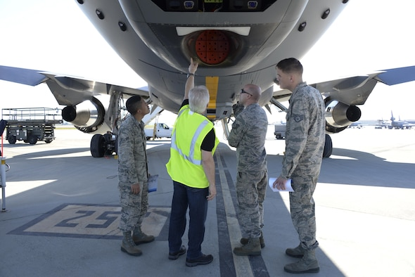 Steve Bentley, second from the right, a Boeing quality assurance lead, shows 60th Air Mobility Wing Airmen the KC-46 Pegasus March 8, 2017, at Travis Air Force Base, Calif. Travis was selected in January as a preferred location for the Air Force's newest refueling aircraft. (U.S. Air Force photo by Senior Airman Amber Carter)
