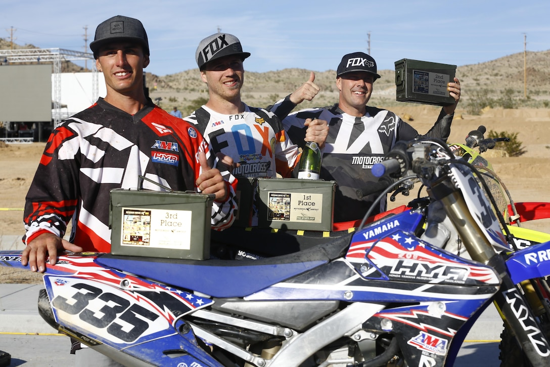 John Jelderda, Dennis Stapleton and Jeremy McCool, winners of the Motocross Jam Fest, proudly display their trophies at the conclusion of the event at 13th and Dunham aboard Marine Corps Air Ground Combat Center, Twentynine Palms, Calif., March 11, 2017. Marine Corps Community Services hosts the Motocross Jam Fest annually to provide Combat Center patrons with the opportunity to enjoy time out with their family and friends.  (U.S. Marine Corps photo by Lance Cpl. Natalia Cuevas)