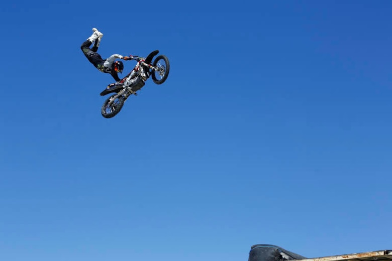 Jumping specialist Jimmy Fitzpatrick performs stunts during the Motocross Jam Fest, at 13th and Dunham aboard Marine Corps Air Ground Combat Center, Twentynine Palms, Calif., March 11, 2017. Marine Corps Community Services hosts the Motocross Jam Fest annually to provide Combat Center patrons with the opportunity to enjoy time out with their family and friends. (U.S. Marine Corps photo by Lance Cpl. Natalia Cuevas)