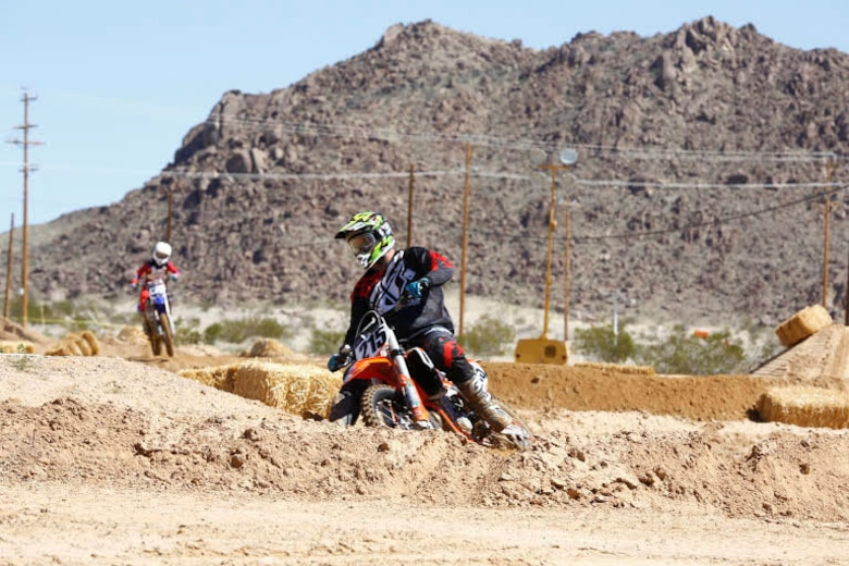 Riders compete to get first place during the Motocross Jam Fest, at 13th and Dunham aboard Marine Corps Air Ground Combat Center, Twentynine Palms, Calif., March 11, 2017. Marine Corps Community Services hosts the Motocross Jam Fest annually to provide Combat Center patrons with the opportunity to enjoy time out with their family and friends. (U.S. Marine Corps photo by Lance Cpl. Natalia Cuevas)