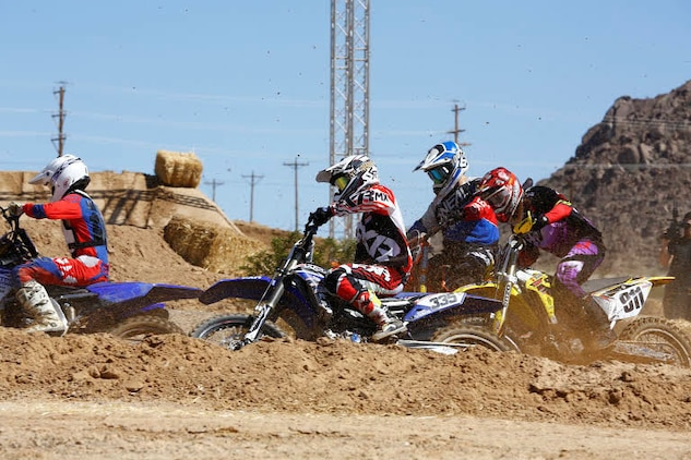 Riders race each other during the Motocross Jam Fest, at 13th and Dunham aboard Marine Corps Air Ground Combat Center, Twentynine Palms, Calif., March 11, 2017. Marine Corps Community Services hosts the Motocross Jam Fest annually to provide Combat Center patrons with the opportunity to enjoy time out with their family and friends. (U.S. Marine Corps photo by Lance Cpl. Natalia Cuevas)