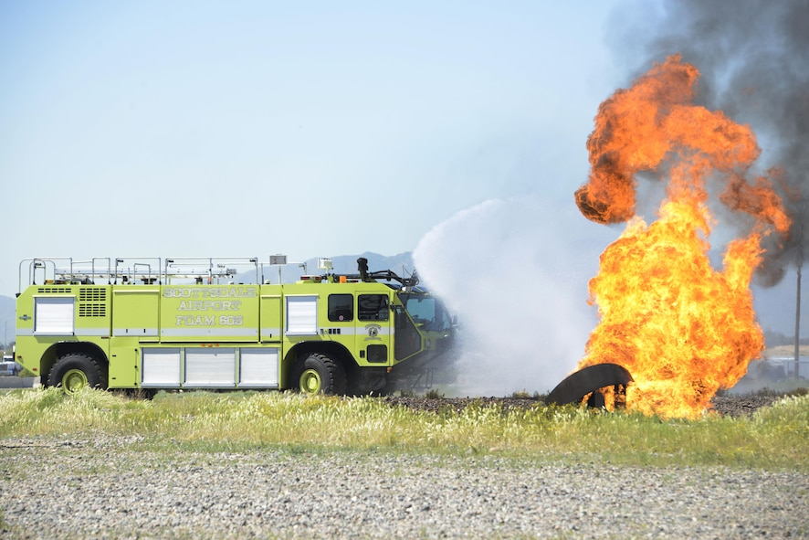 The Scottsdale Fire Department use a rapid intervention vehicle to respond to a simulated aircraft fire during training with Luke firefighters Mar. 16, 2017 at Luke Air Force Base, Ariz. The firefighters were training on stabilizing an aircraft fire using RIVs. (U.S. Air Force photo by Senior Airman Devante Williams)