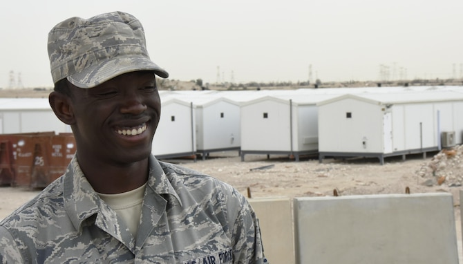 U.S. Air Force Tech. Sgt. Dominique Knowles, project manager with the 379th Expeditionary Civil Engineer Squadron Water and Fuels Section, poses for a photo at Al Udeid Air Base, Qatar, March 15, 2017. Knowles is the project manager for the replacement portion of the 379th ECES cadillac trailer plan, one part of the continued improvement of facilities at Al Udeid AB. (U.S. Air Force photo by Senior Airman Cynthia A. Innocenti)