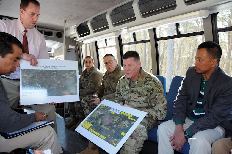Col. Martin Klein, U.S. Army Support Activity Fort Dix commander, discusses range capabilities March 17 at Joint Base McGuire-Dix-Lakehurst, New Jersey, during a bus tour as part of a congressional staff visit.  The joint base spans more than 20 miles east to west equaling 42,000 contiguous acres.  Joint Base McGuire-Dix-Lakehurst is home to more than 80 mission partners who provide a wide range of combat capability.