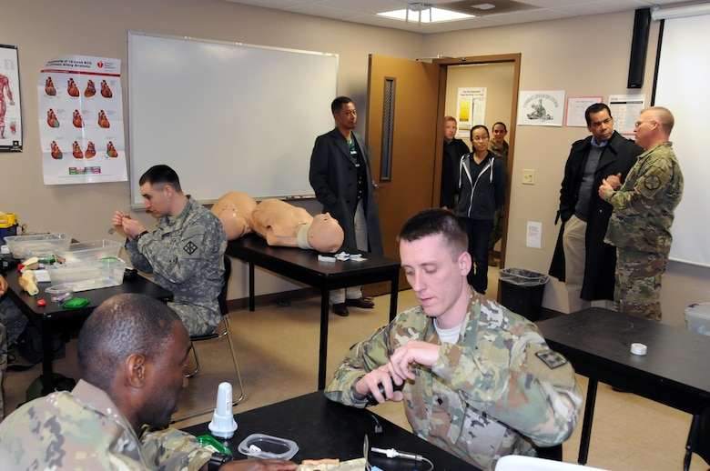 Sgt. 1st Class David Lovett (right), course coordinator at the Army Reserve's Medical Skills Training Center at Joint Base McGuire-Dix-Lakehurst, New Jersey, shows congressional staff members a training class March 17.  The day was designed to show the various ranges and training sites of the joint base. Joint Base McGuire-Dix-Lakehurst is home to more than 80 mission partners who provide a wide range of combat capability.