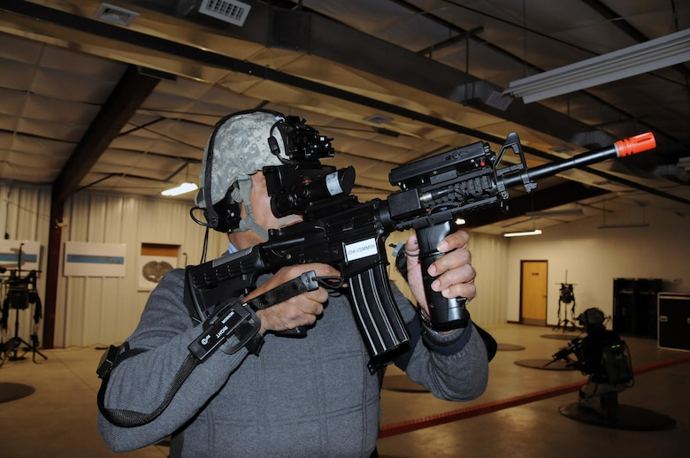 Keith Roachford, Special Projects director at the Office of U.S. Senator Robert Menendez, runs through a mission March 17 at the dismounted Soldier training system at Joint Base McGuire-Dix-Lakehurst, New Jersey.  Roachford and other congressional staff members visited to see the various ranges and training sites of the joint base. Joint Base McGuire-Dix-Lakehurst is home to more than 80 mission partners who provide a wide range of combat capability.