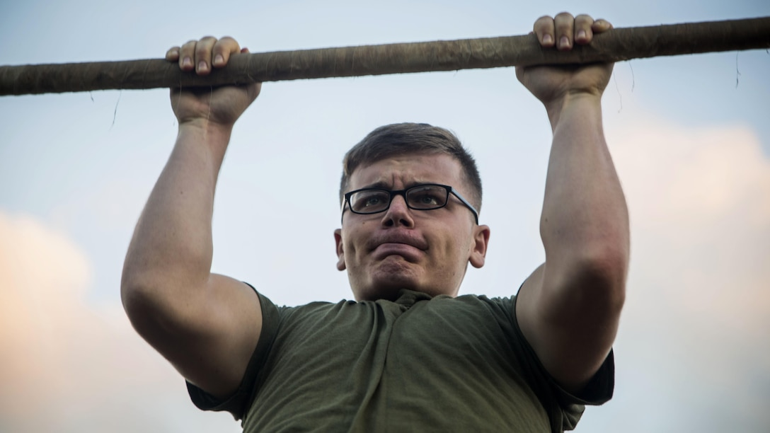 Lance Cpl. Austin Walls, a technical controller with Headquarters Battalion, conducts pull-ups during a Physical Fitness Test at Marine Corps Base Hawaii, March 14, 2017. The PFT is an evaluation conducted throughout the Marine Corps annually to assess the level of fitness. For more information on the PFT updates, utilize Marine Corps Bulletin 6100.